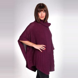 Knit poncho with side buttons